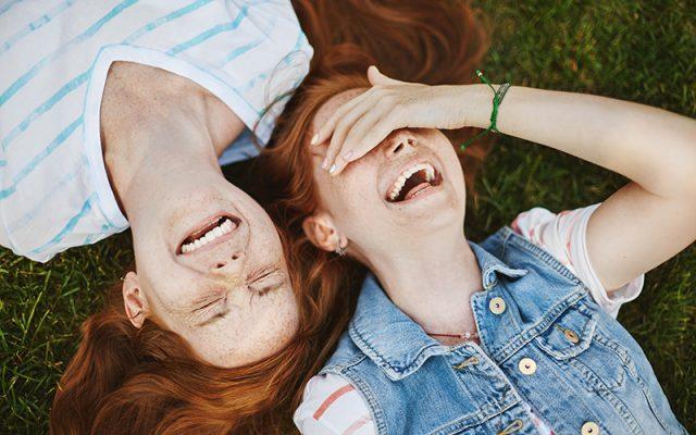 twin girls laughing