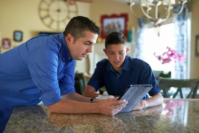 young_men_fathers_tablets_studying-1024x682